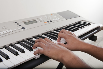 playing the electronic piano