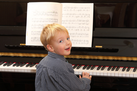 young child playing the piano